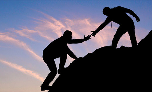 Mentoring image with helping hand. Donaldson Consulting LLC played a key role in the development and implementation of SafeBuild Alliance's mentoring program.