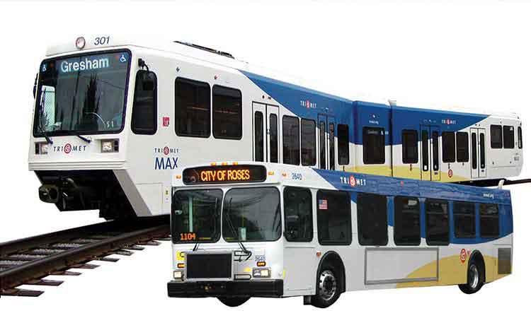 Image of TriMet MAX train and bus.